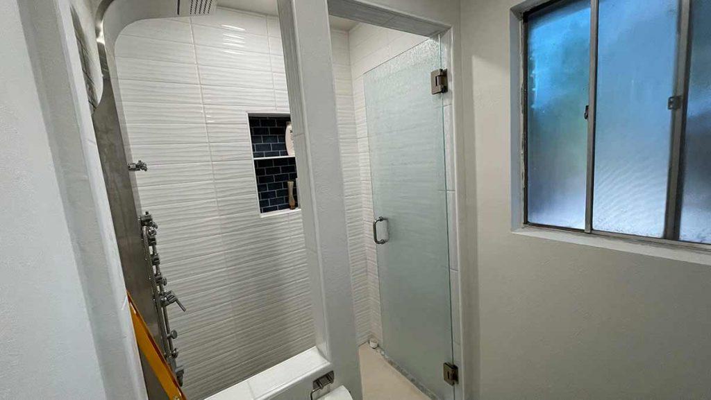 Bathroom Glass being installed